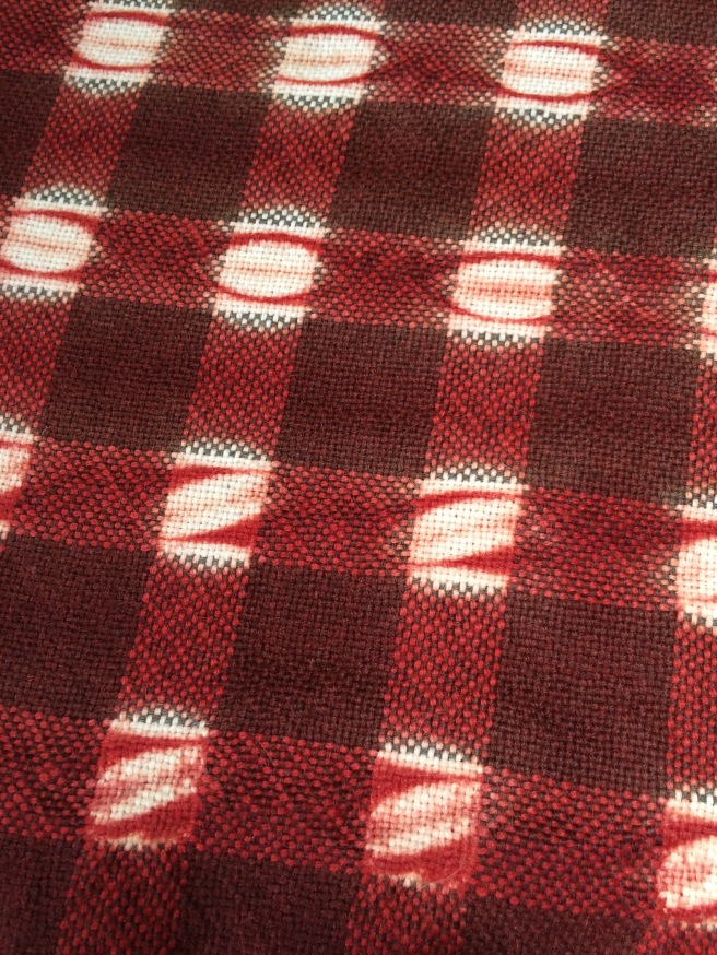 Alpaca, woven shibori resist, dyed with madder (rubia tinctoria), inspired by  check patterned textile from China and Mexico