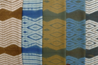 Sequencing dye and resists: wool, dyed with indigo and black walnut hulls.