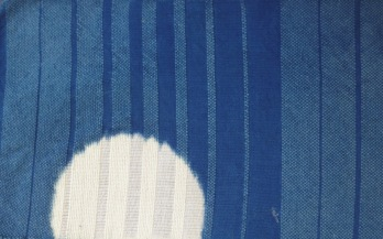 Fabric woven of cotton and wool. Clamped resist, indigo dyed.