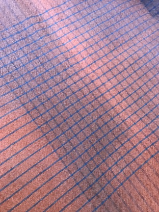 Woven wool and cotton, dyed with madder and indigo. Fading occurs on the wool at the fold lines. It had been stored away from any light.